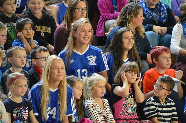 Students in stadium seating at Pep Rally for girls' soccer team