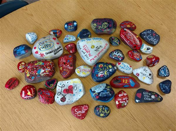 Painted Rocks with inspirational saying for the Kindness Rocks project